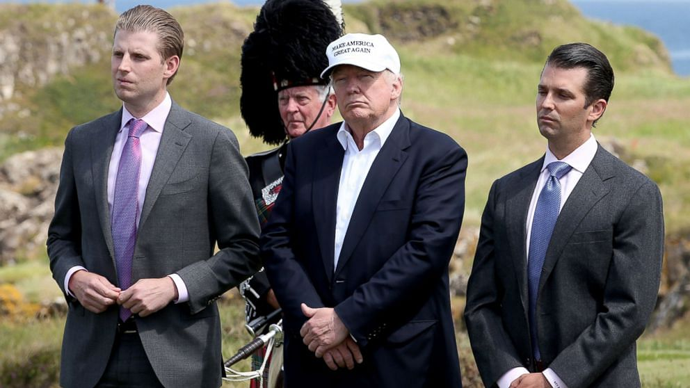 Eric Trump standing to the left of Donald Trump