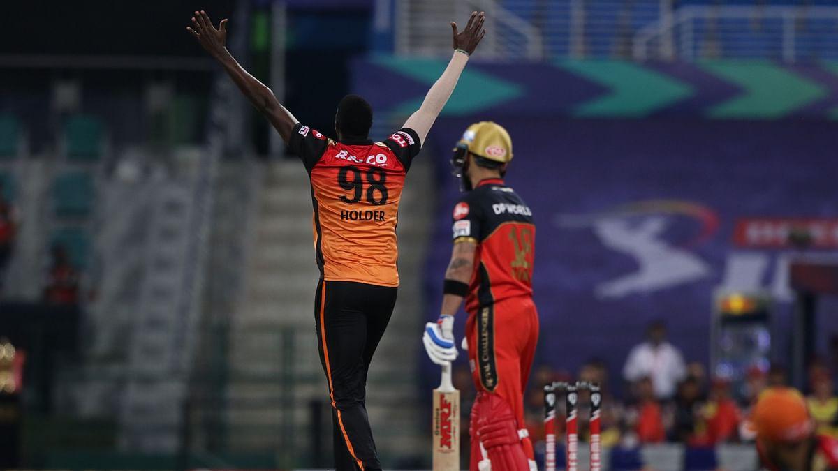 Jason Holder celebrates the dismissal of Virat Kohli.