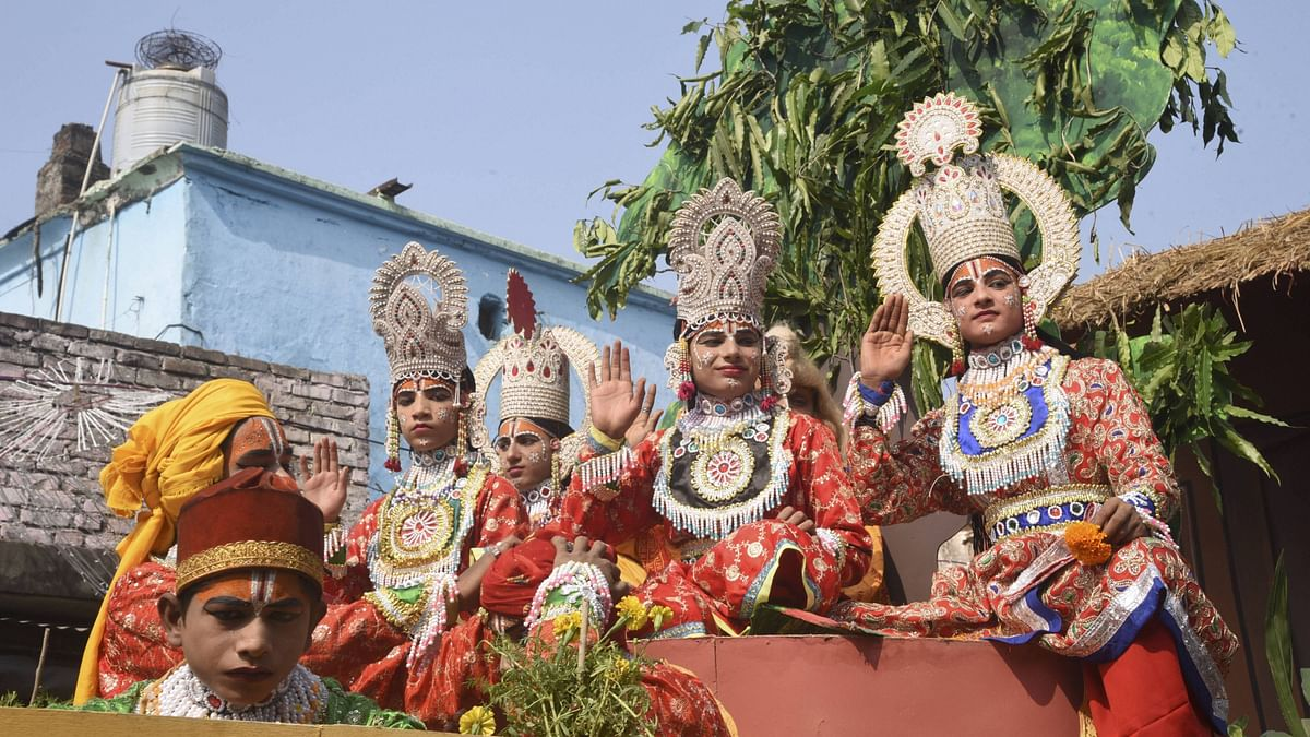 A tableau depicting Lord Ram passes through a street on the eve of Diwali festival, in Ayodhya, Friday, 13 November.