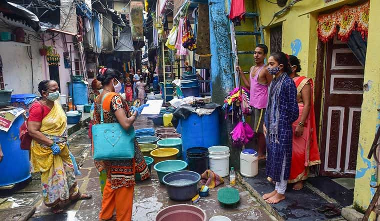 Health care workers conduct door-to-door survey in Dharavi