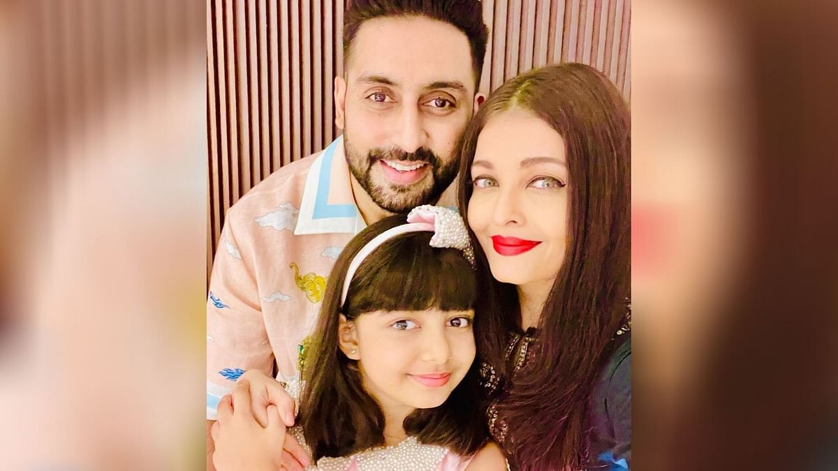 Aishwarya and Abhishek Bachchan with Aaradhya on her birthday.