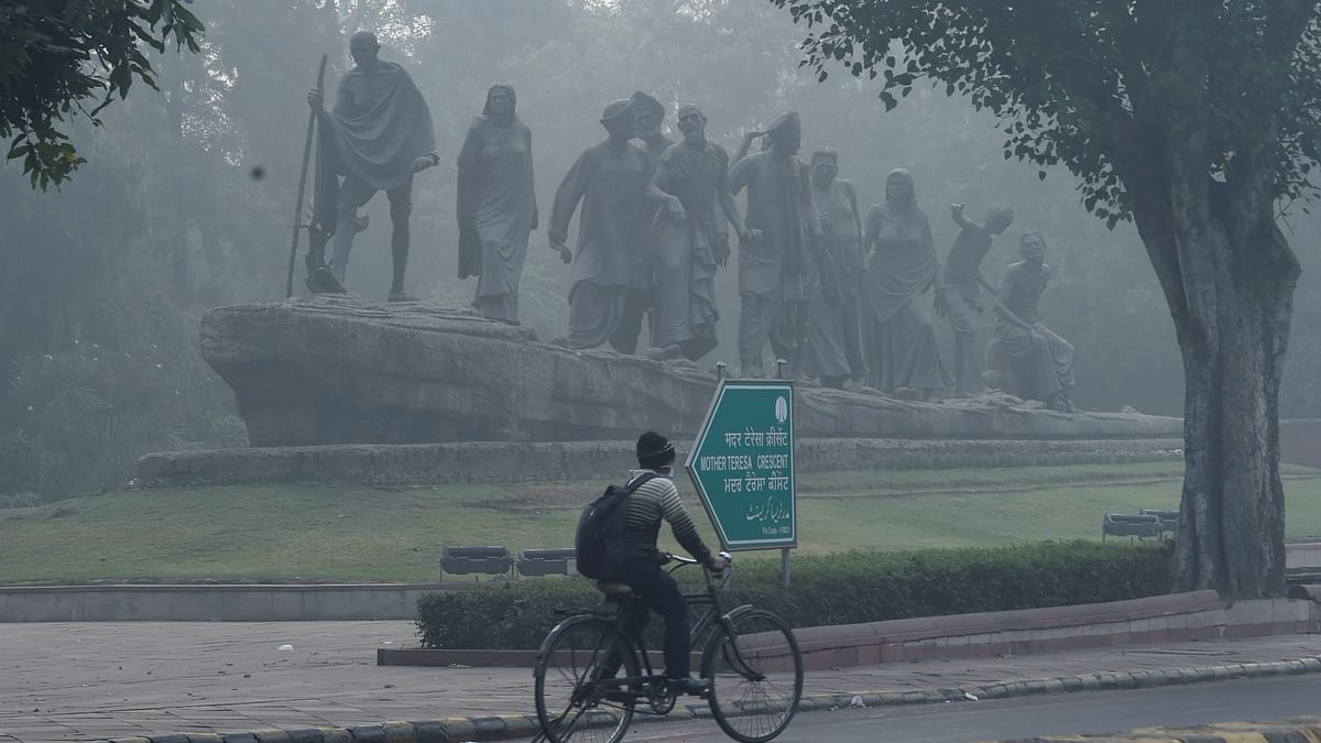 A cyclist rides through smog post Diwali celebrations, in New Delhi on Sunday, 15 November. Image used for representation only,