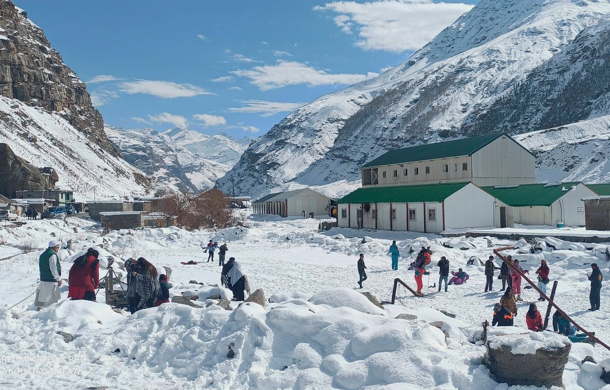 Tourists play in the snow near the Atal Tunnel, in Lahaul-Spiti.