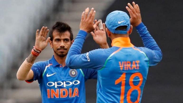 Yuzvendra Chahal and Virat Kohli celebrate a wicket.