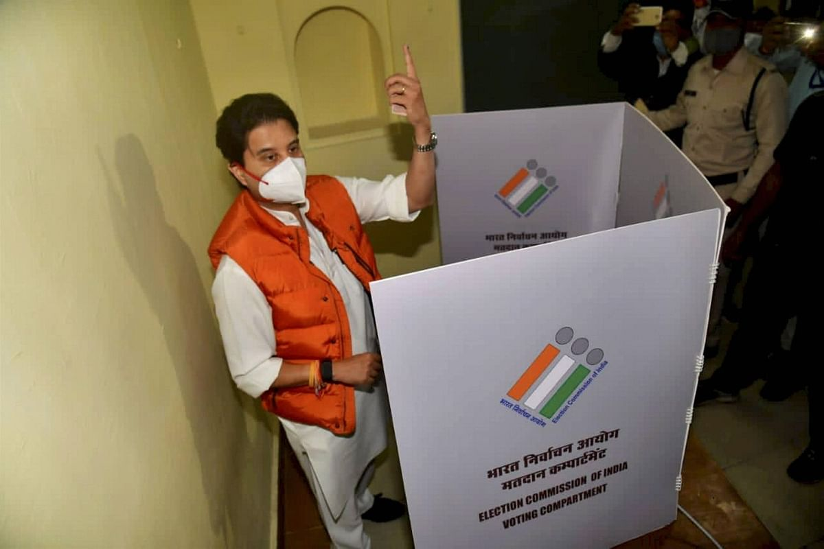 BJP leader Jyotiraditya Scindia raises  his finger before casting vote during the Madhya Pradesh Assembly bypolls, amid the ongoing coronavirus pandemic, in Gwalior district, Tuesday, 3 November.