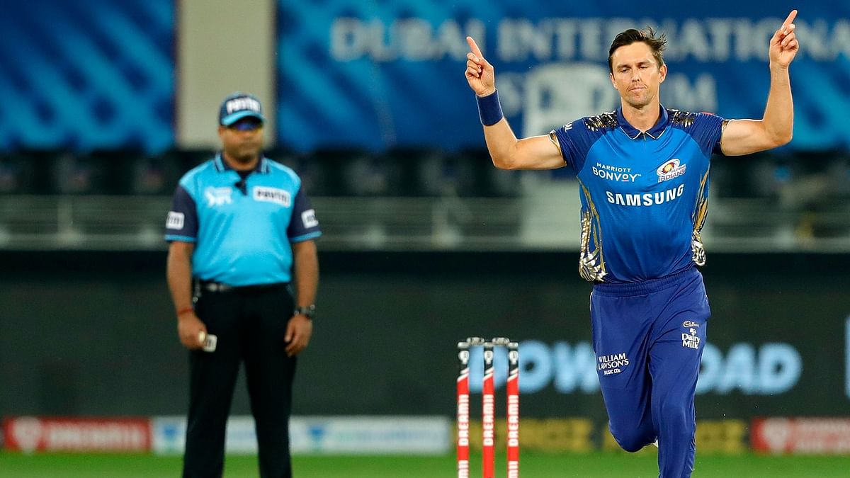 Trent Boult celebrates taking a wicket in the first over of Delhi's innings.