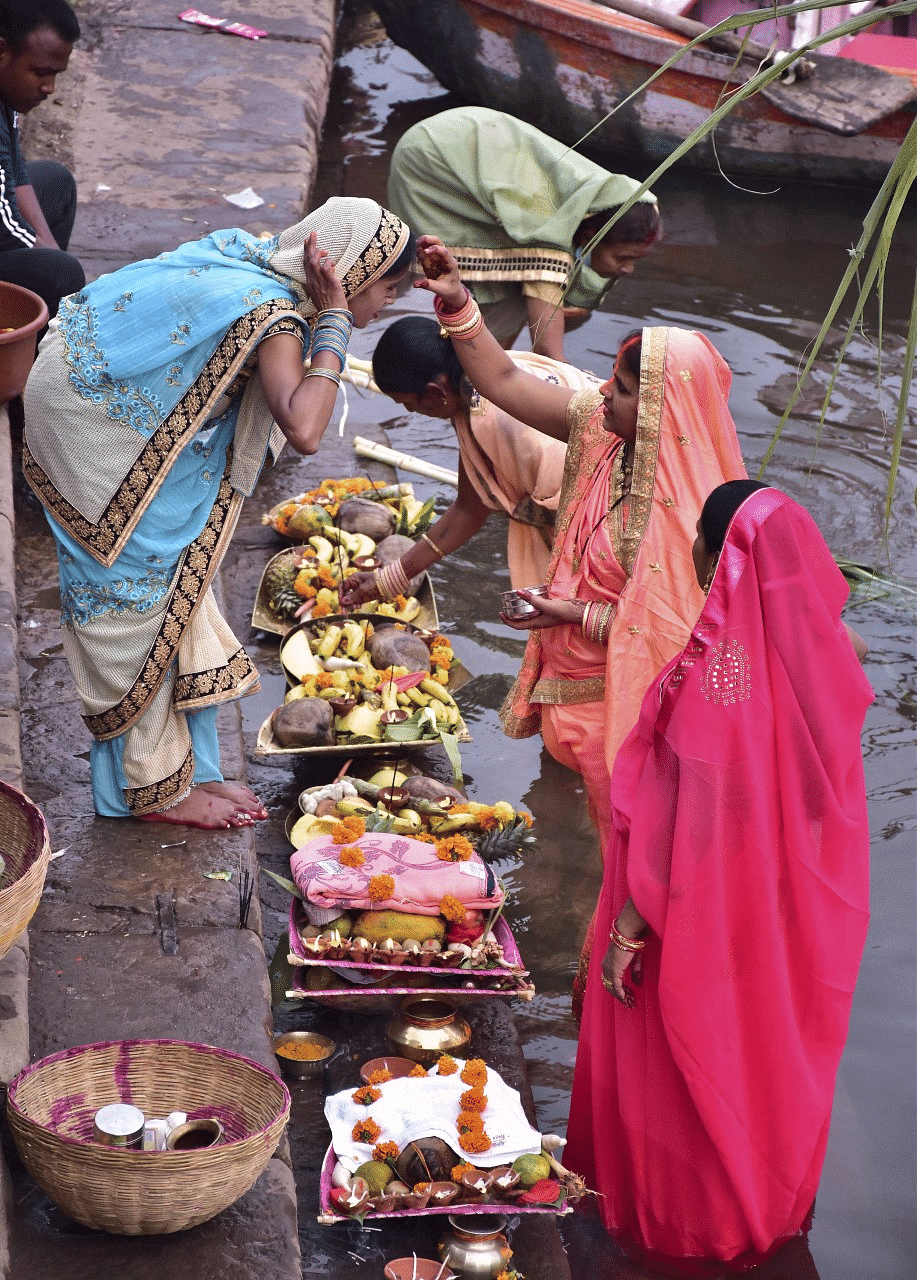 Women take part in rituals after taking a holy dip in the Narmada river on the occasion of Chhath Puja in Jabalpur.