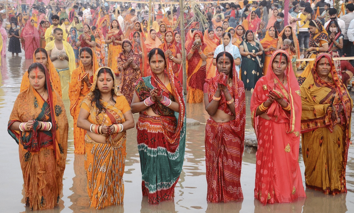 Devotees pray on the banks of Brahmaputra river on the occasion of Chhath Puja in Guwahati.
