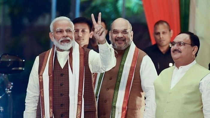 Prime Minister Narendra Modi arrives to address his supporters at the BJP headquarters in New Delhi in October 2019 after declaration of Haryana and Maharashtra assembly polls' results. JP Nadda photographed behind Modi-Shah.