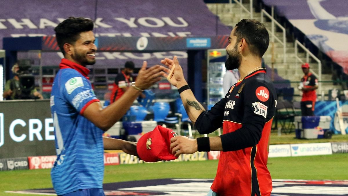 Here's why RCB are through to the playoffs despite losing to Delhi Capitals on Monday.