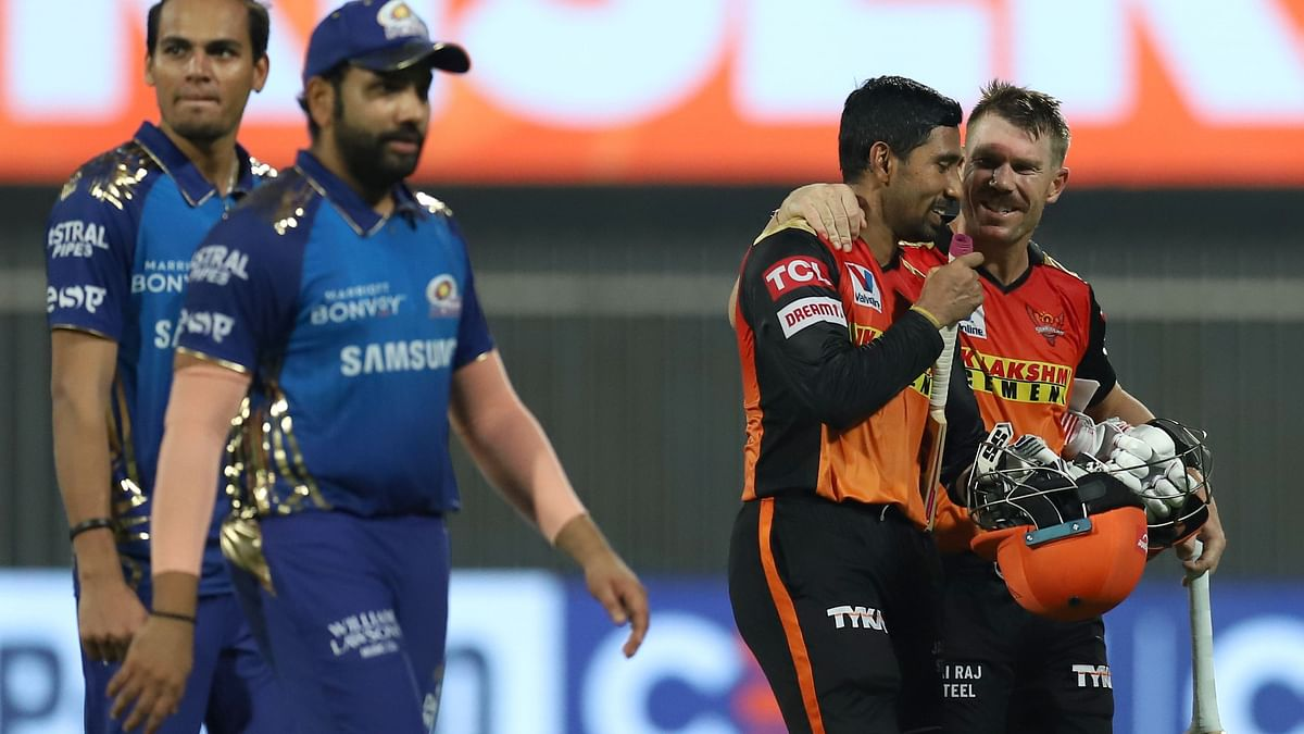 David Warner and Wriddhiman Saha's fifties took SRH over the line by 10 wickets against MI