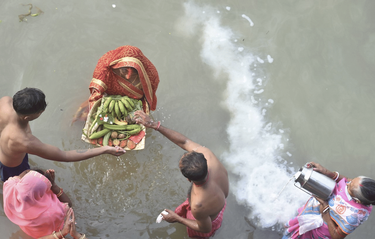 Devotees perform rituals at the bank of River Ganga, on the occasion of Chhath Puja in Kolkata.