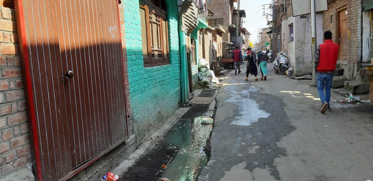 An overflowing drain at a Sheikh Ghetto in Srinagar's Old City.