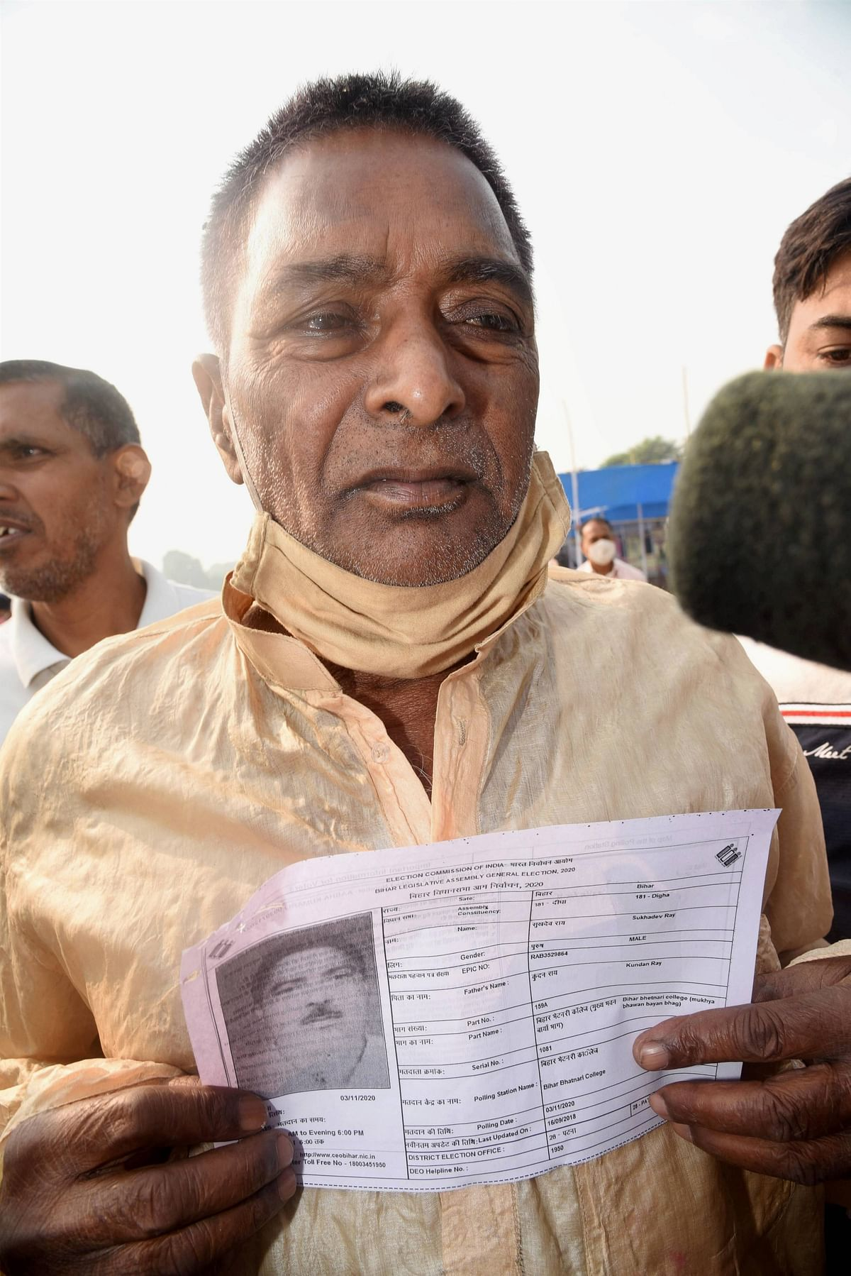 RJD Chief Lalu Prasad Yadavs brother Sukhdev Rai shows his ID after casting vote during the second phase of Bihar assembly polls.