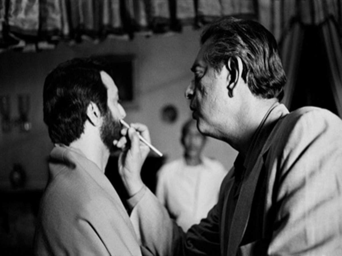 Satyajit Ray doing Soumitra Chatterjee's make-upduring the shoot of 'Apur Sansar'