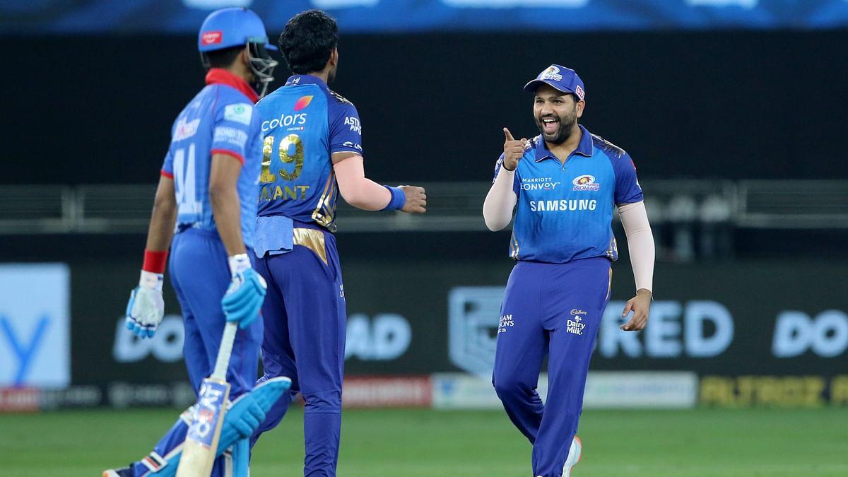 Jayant Yadav and Rohit Sharma celebrate the wicket of Shikhar Dhawan.