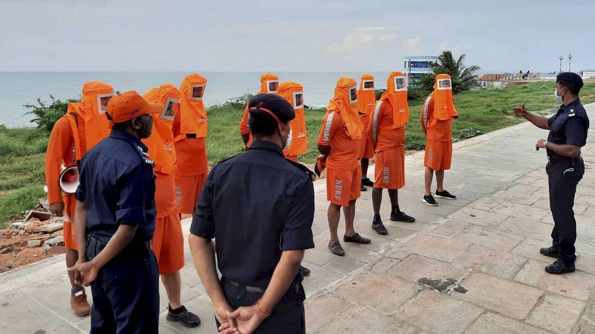 NDRF personnel arrive near the seashore in the view of Cyclone Burevi, in Kanyakumari.