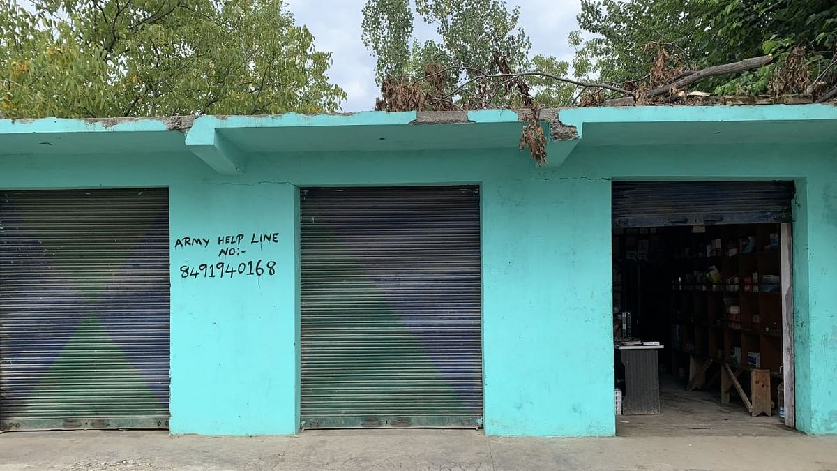 Army's 'helpline number' in Amshipora. Often it is used by locals to tip off forces about the presence of militants.