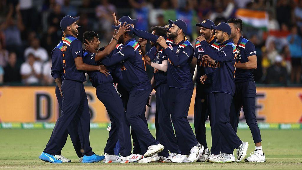 India celebrate a wicket against Australia.