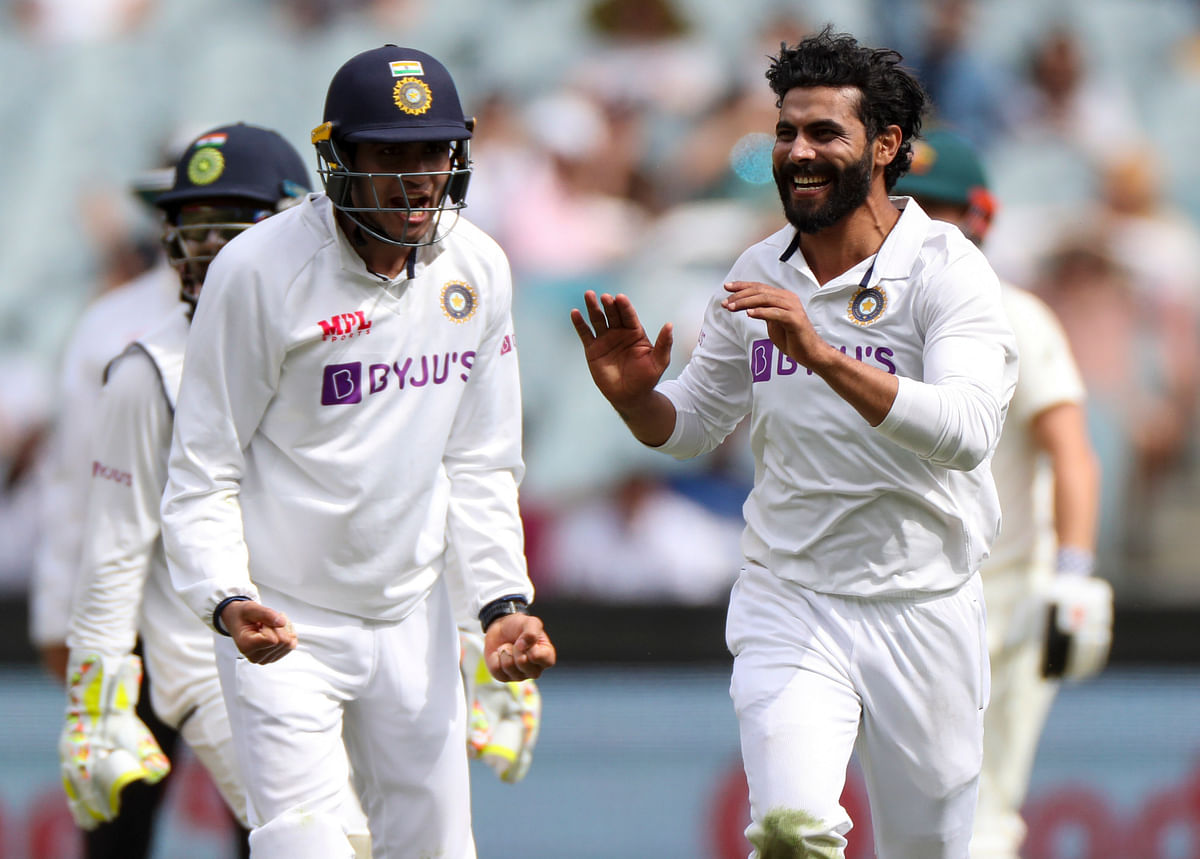 Ravindra Jadeja, right, celebrates after taking the wicket of Australia's Matthew Wade during day three of the second  test between India and Australia at the Melbourne Cricket Ground.