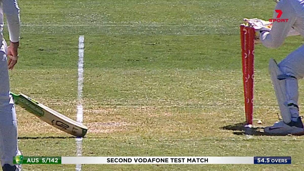 Australia skipper Tim Paine survives a close run out decision against India in Melbourne.