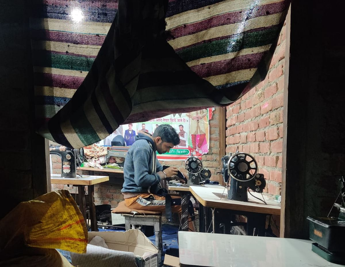 """Arshad is a tailor and has two people working with him. """"I make Rs 200 or so a day,"""" he says."""