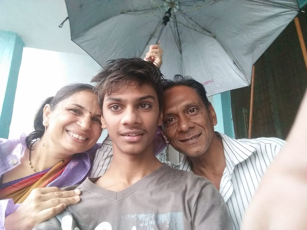 Shivam with his parents.