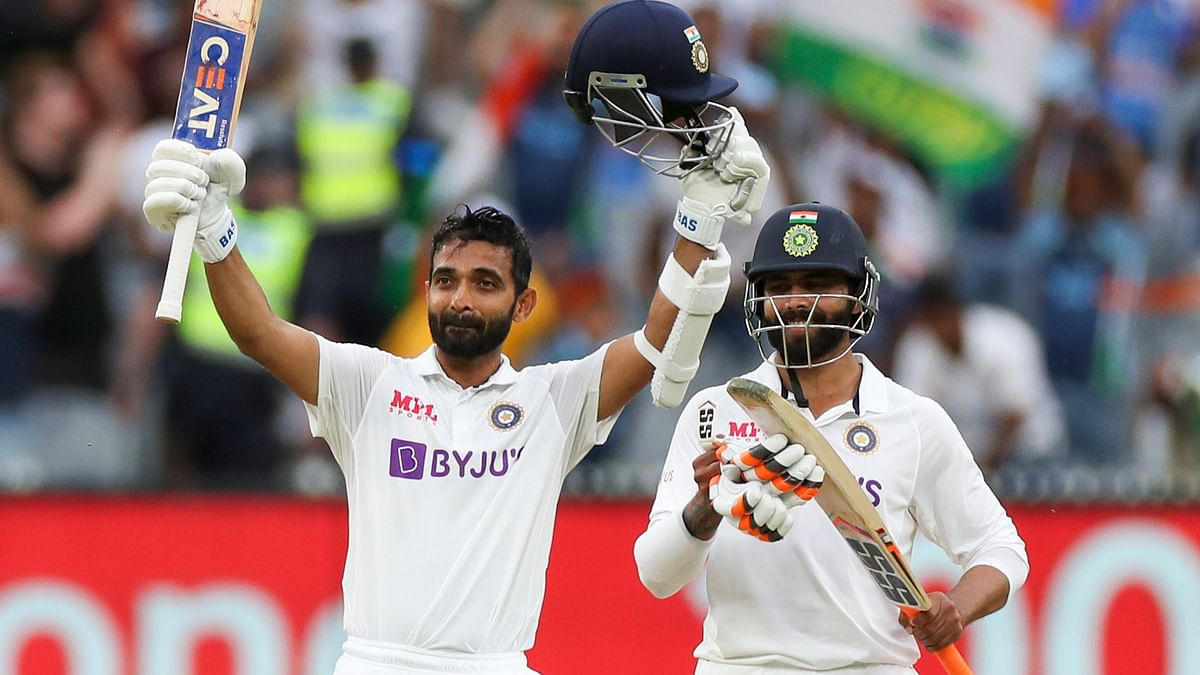 Ajinkya Rahane acknowledges the applause after completing his century on Day 2 of the Boxing Day Test in Melbourne.