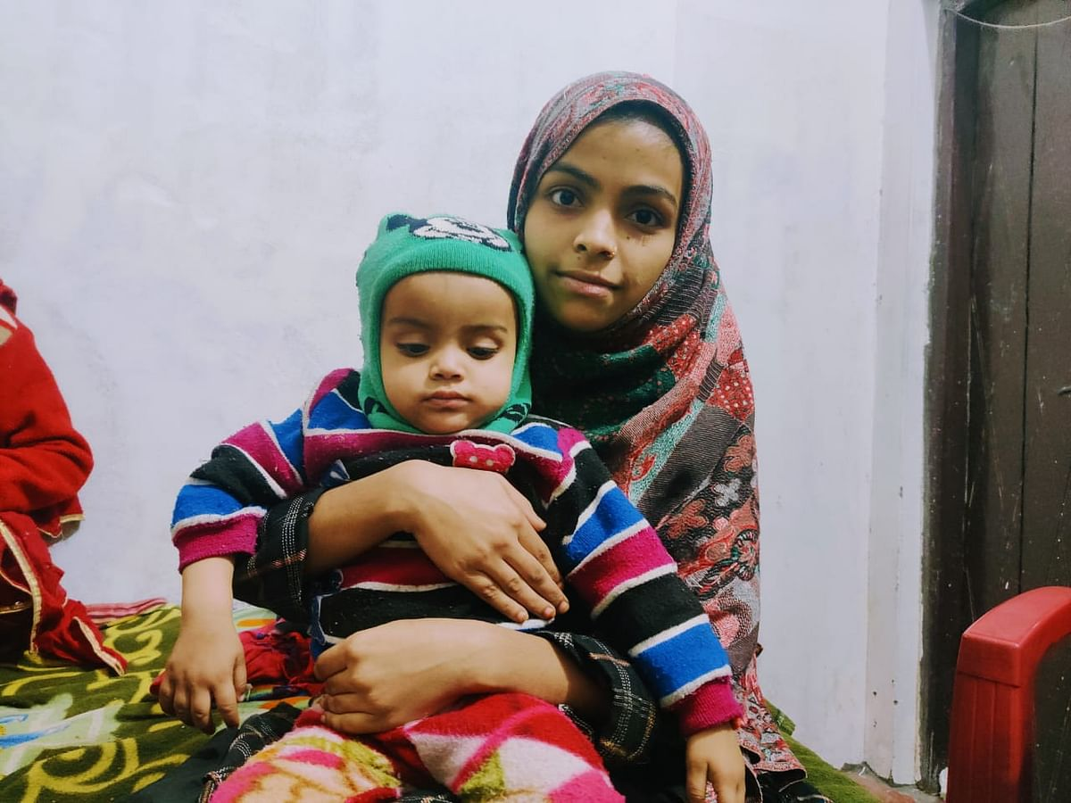 """Aarzoo and her and Arshad's son Adeeb. """"My son does not know about his father, he does not understand, he does not need to know,"""" she says."""