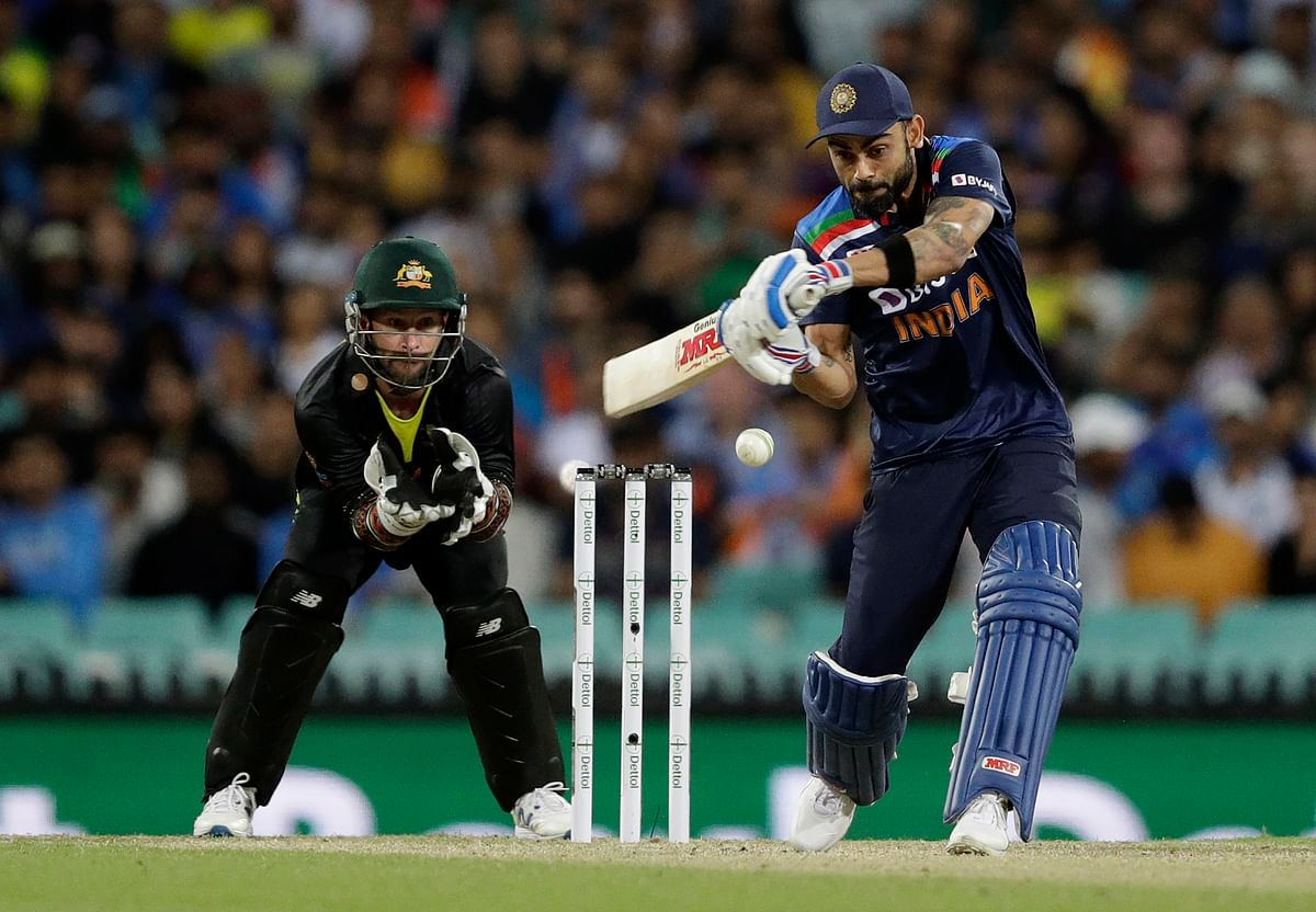 India's captain Virat Kohli, right, bats during the third T20 international between Australia and India at the Sydney Cricket Ground in Sydney.