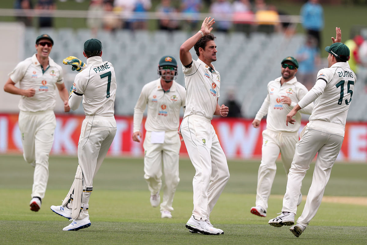 Australia's Mitchell Starc, third right, celebrate with teammates after bowling India's Prithvi Shaw during their cricket test match at the Adelaide Oval in Adelaide, Australia, Thursday, Dec. 17, 2020.