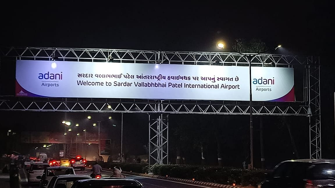 The hoarding shows 'Welcome to Sardar Vallabhbhai Patel International Airport' while entering the airport.