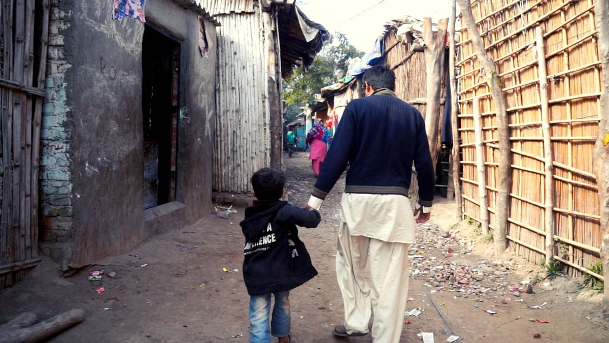 Manohar Lal with his son at the Majnu ka Tilla refugee camp in North Delhi.