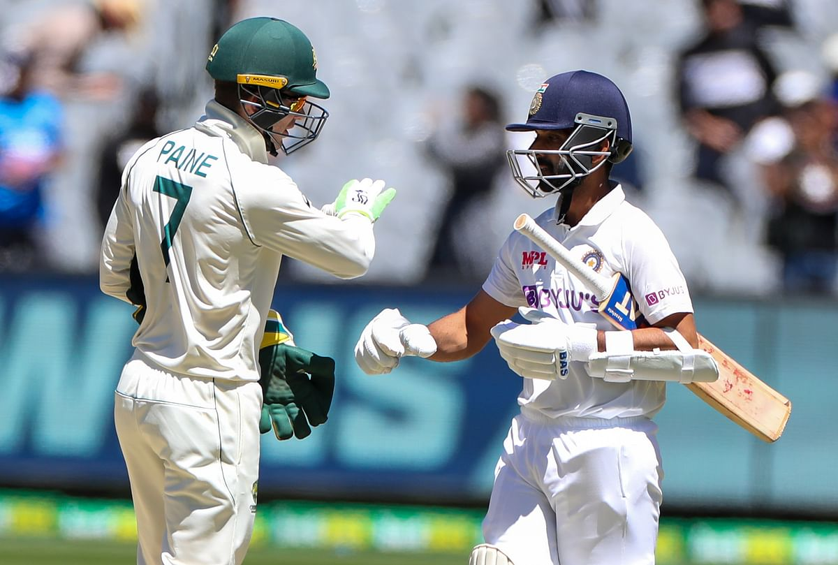 Australian captain Tim Paine, left, congratulates Indian captain Ajinkya Rahane after winning the second test at the Melbourne Cricket Ground.