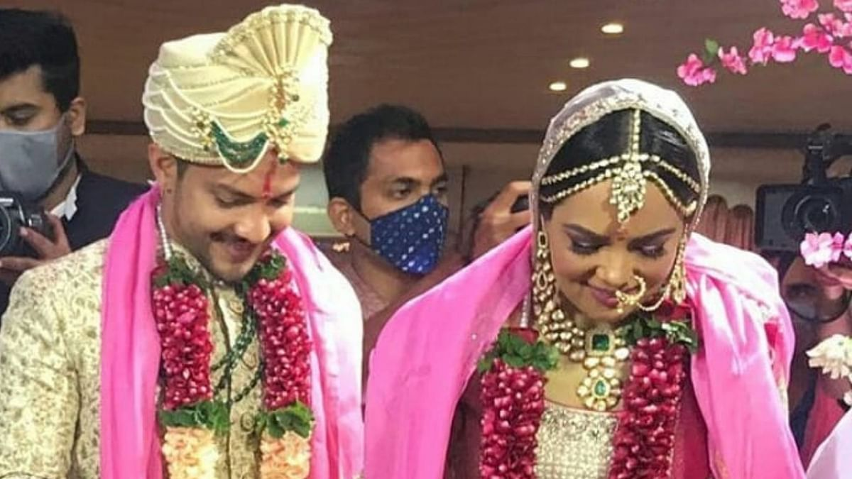 Aditya Narayan and Shweta Agarwal smile coyly during their wedding.