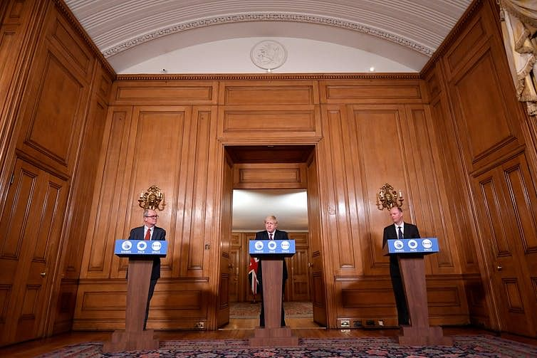 Prime Minister Boris Johnson addressed the nation with his chief advisors to announce new restrictions.