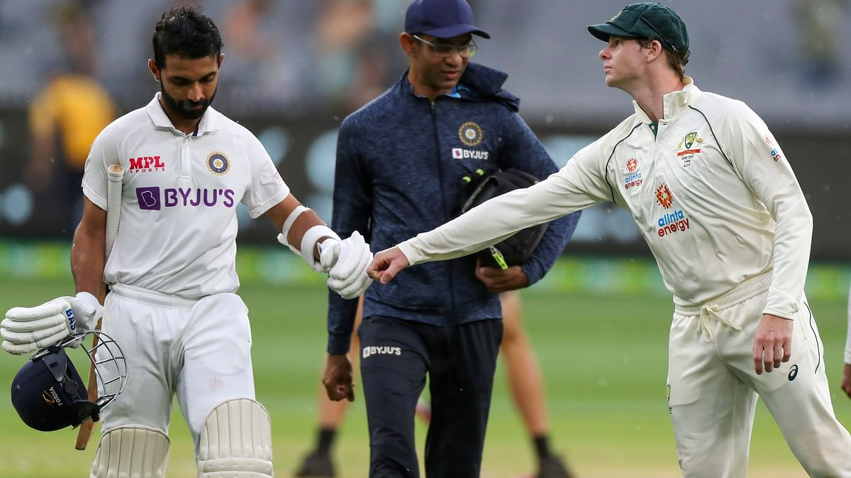 Ajinkya Rahane congratulated by Steve Smith after his century on Day 2 at Melbourne.