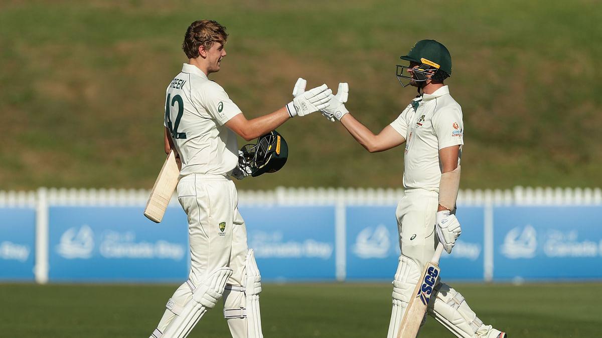 Cameron Green celebrates scoring a century against India A