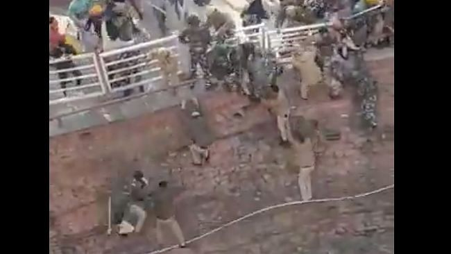 Red Fort: In Video, Cops Jump into Pit to Escape Agitating Farmers