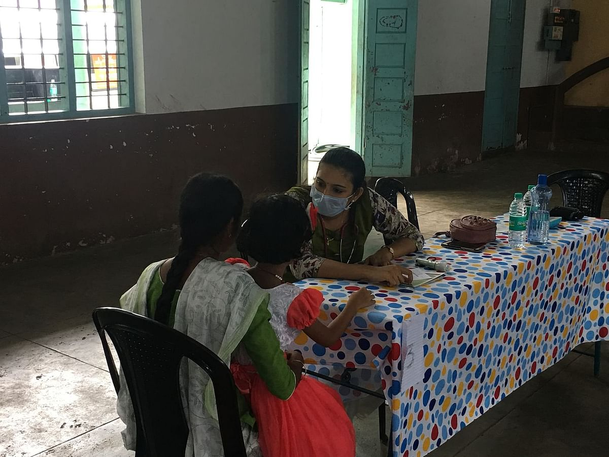 A doctor conducting check-ups at a medical camp in North Paravur, one of the worst affected ones in Kerala.