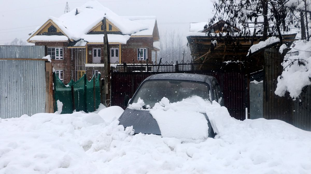 In Pics: Power Outage in J&K, Valley Cut Off After Heavy Snowfall