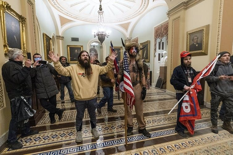 Trump supporters breached the Capitol carrying Trump flags and dressed in costumes.