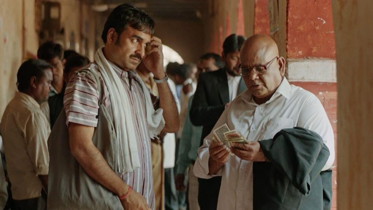 Pankaj Tripathi and Satish Kaushik in <i>Kaagaz.</i>