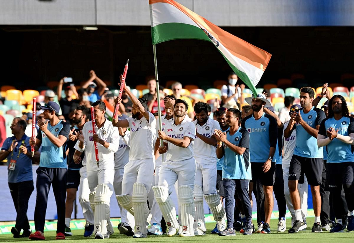 Brisbane: Indian players celebrate after defeating Australia by three wickets on the final day of the fourth cricket test match at the Gabba, Brisbane, Australia, Tuesday, Jan. 19, 2021. India won the four test series 2-1.