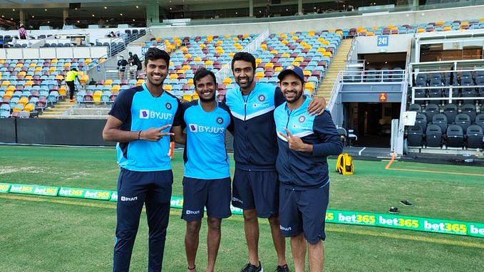 T Natarajan with R Ashwin, Washington Sundar and Shardul Thakur pose for a picture at the Gabba.