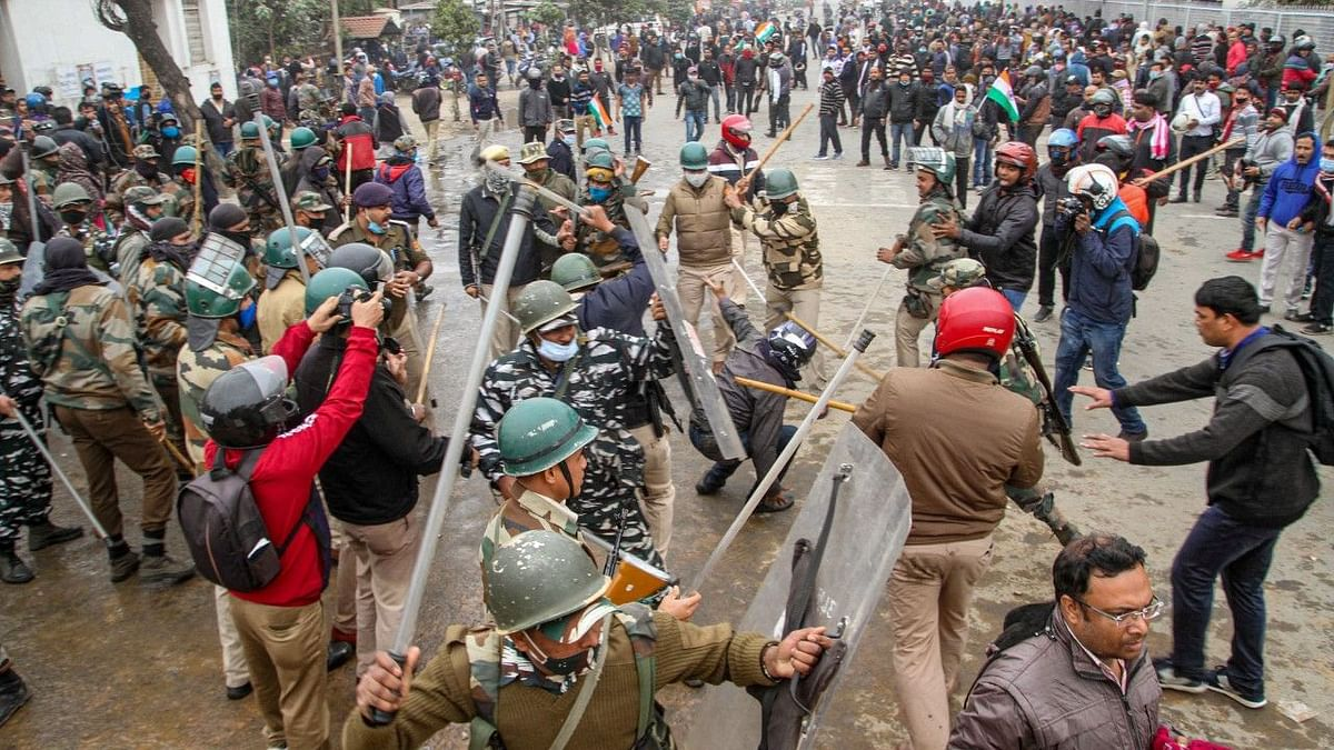 Agartala: Police personnel use tear gas shells on teachers to disperse them during their protest, in Agartala, Wednesday, 27 January 2021. The authorities-imposed restrictions under Section 144 in the city amid the ongoing protest of teachers.