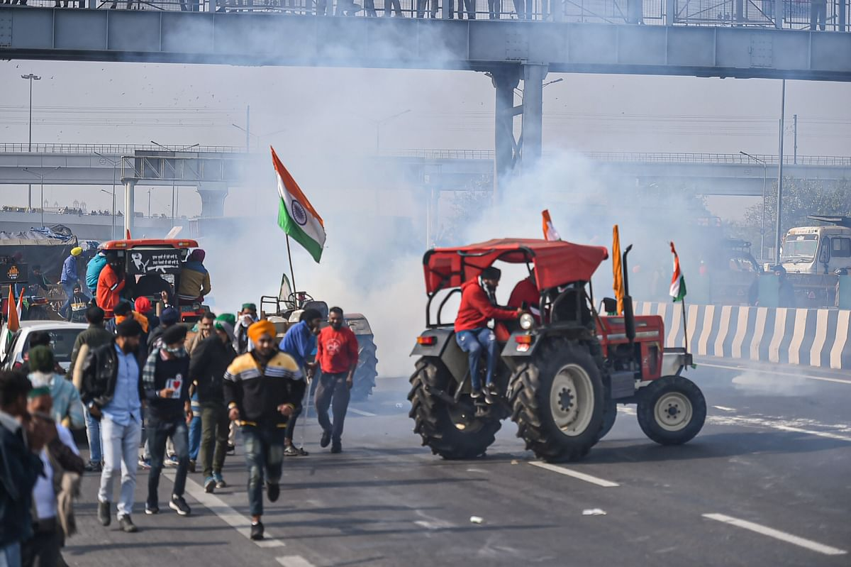 Police used tear gas to disperse farmers attempting to break barricades at Ghazipur border.
