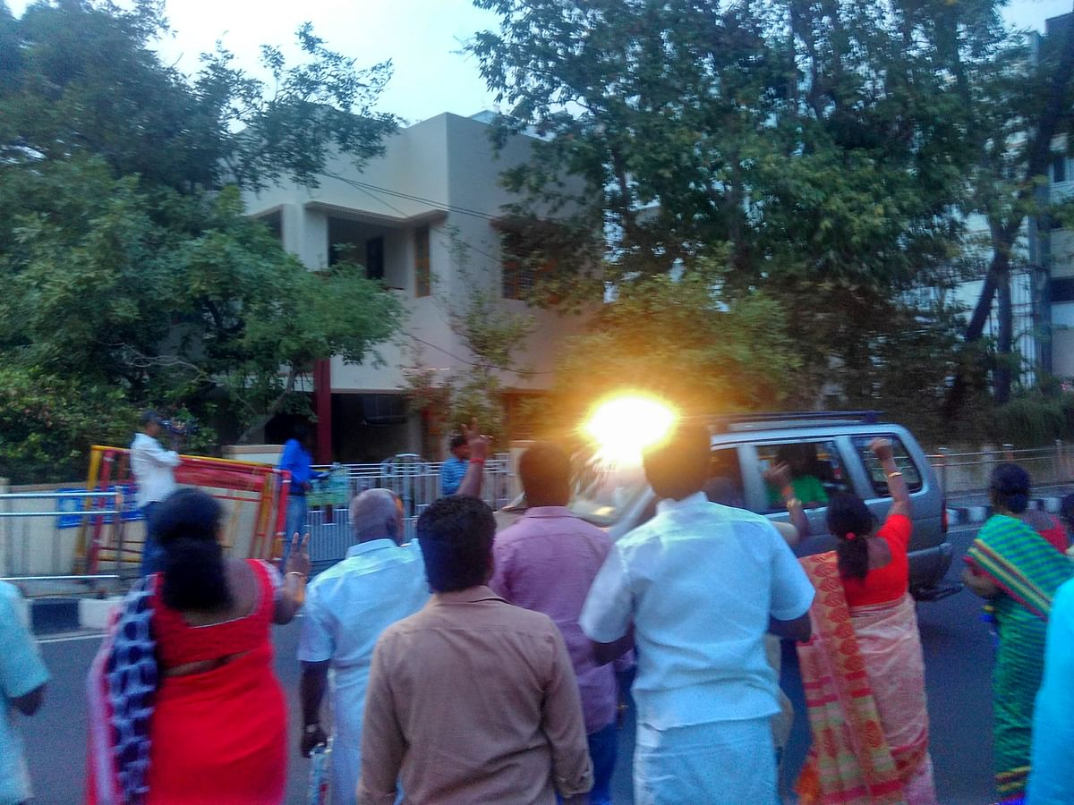 This photo is from February 2016 of Jayalalithaa leaving her residence to people waving to her. The bright light seen in the photo is of the light that is strategically placed inside the car so that <i>Amma's </i>face looks lit up.
