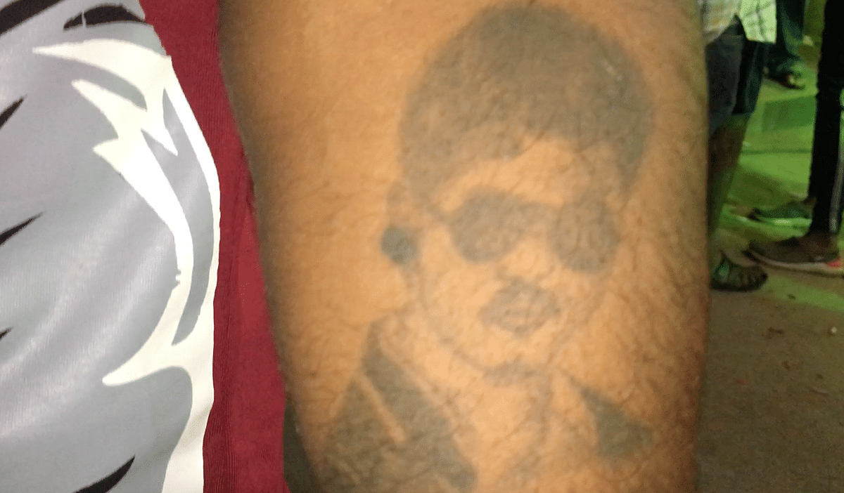 Guru showing off his Vijay tattoo.