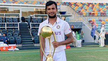 T Natarajan poses with the Border-Gavaskar Trophy at the Gabba.